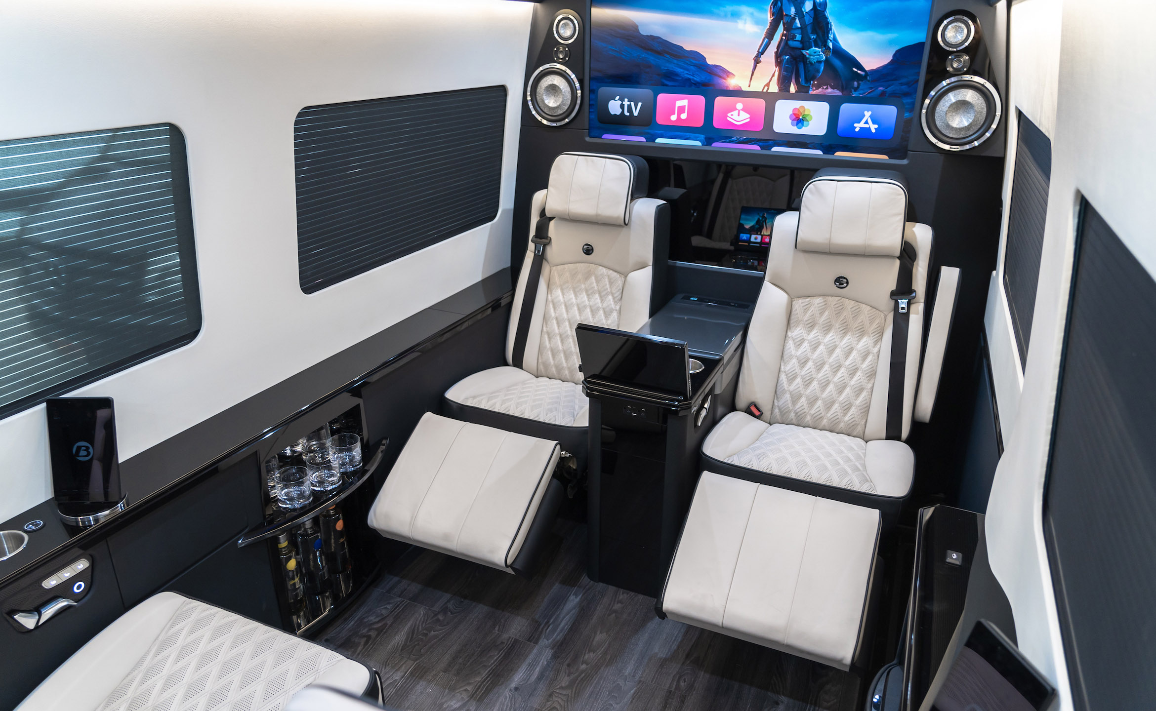 Custom Interior Bespoke Mercedes Benz Luxury Sprinter Van Conversion, Bathroom, & Luxury Mobile Offices.